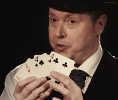 Peter as Charles Dickens showing four cards